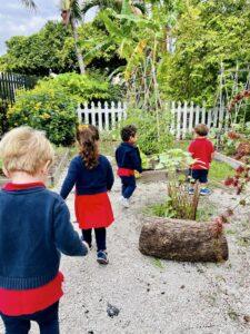 children discovering a montessori garden